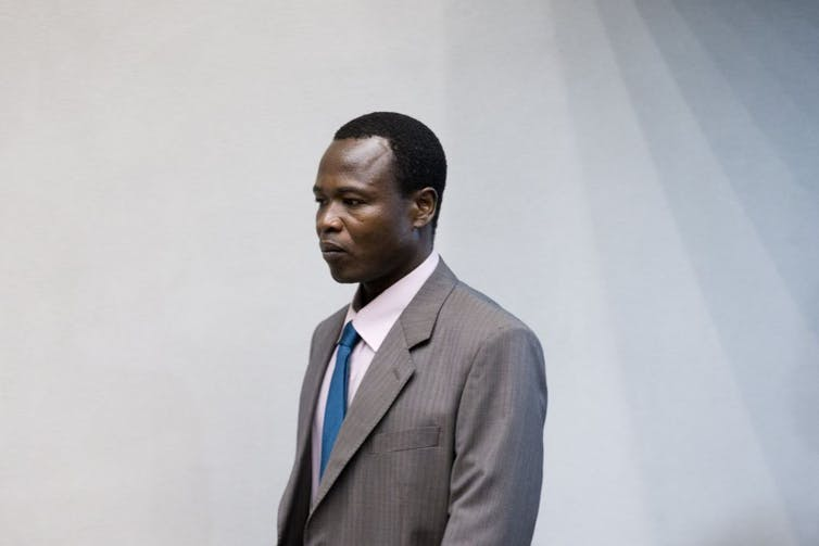 Dominic Ongwen enters the court room of the International Criminal Court (ICC) in The Hague, on December 6, 2016.