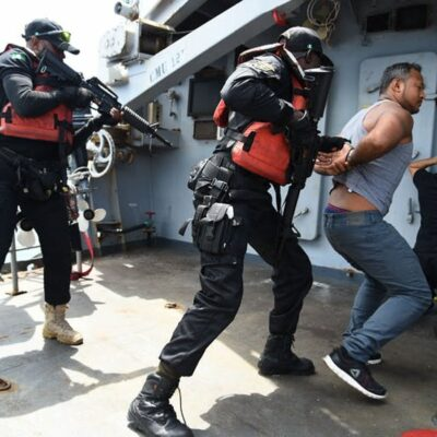 Nigerian Navy Special forces pretend to arrest pirates during a joint military exercise with the French navy.