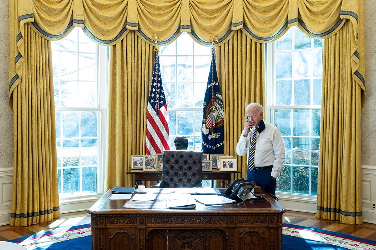 U.S. President Joe Biden talks on the phone with Mexico's President Andrés Manuel López Obrador in the Oval Office of the White House on Jan. 22, 2021. Credit: Official White House Photo by Adam Schultz.