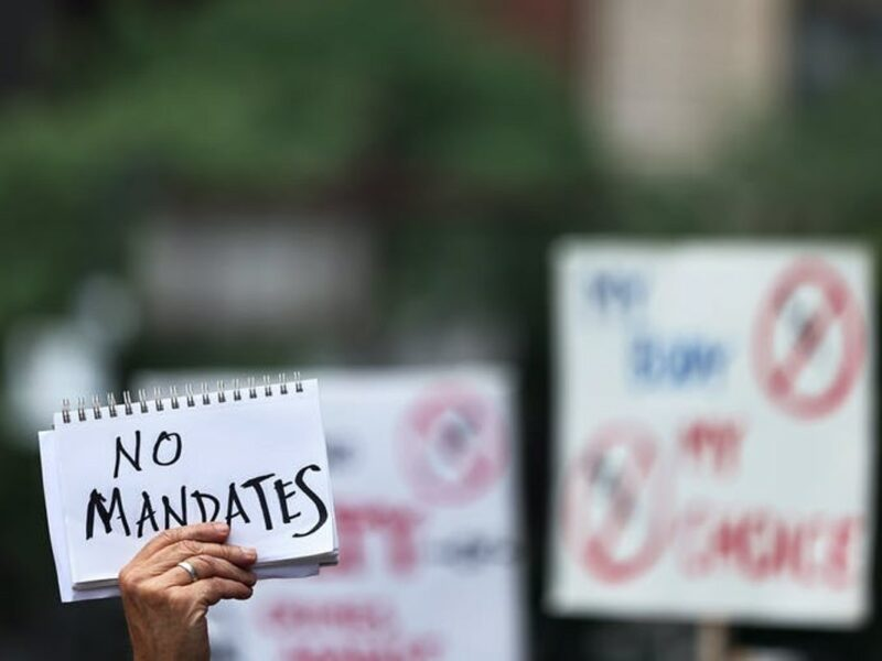 The notion of vaccine mandates is being debated all over the world as some states move to legally require COVID-19 vaccination. Michael M. Santiago/Getty Images